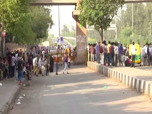 Several people were left stranded at Delhi's Anand Vihar bus terminal on Sunday as the governments of UP and Delhi announced lockdowns to check the spread of COVID-19. Photo/ANI