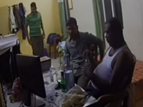 A visual of three constables consuming alcohol inside the Hindupur town police station, Andhra Pradesh. (Photo/ANI)