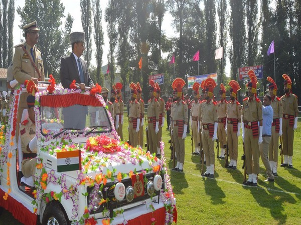 Deputy Commissioner Khalid Jahangir taking salute at the Independence day parade in Anantnag. Photo/ANI