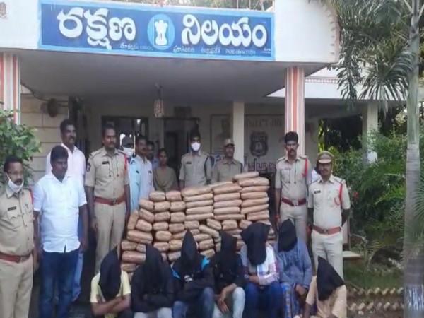 Andhra Pradesh police with ganja and accused. (Photo/ANI)