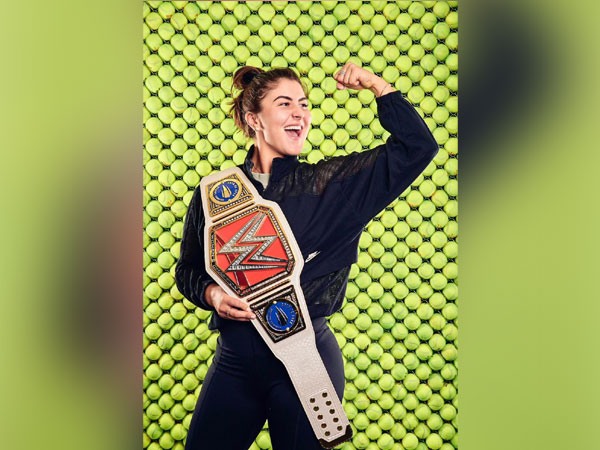 Bianca Andreescu with a customised WWE Championship title