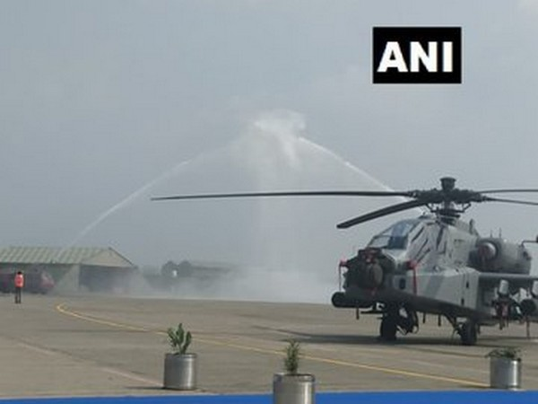 The Apache choppers receive water cannon salute, before induction at the Pathankot Air Base. Photo/ANI