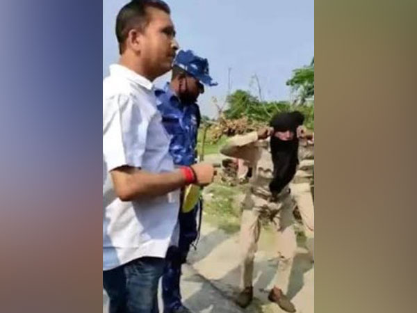 Araria District Agricultural officer Manoj Kumar (in white shirt) in the video grab wherein a security guard is being made to do sit-ups. Photo/ANI