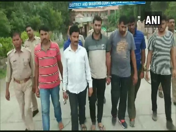 Police with arrested people in Noida on Monday. Photo/ANI
