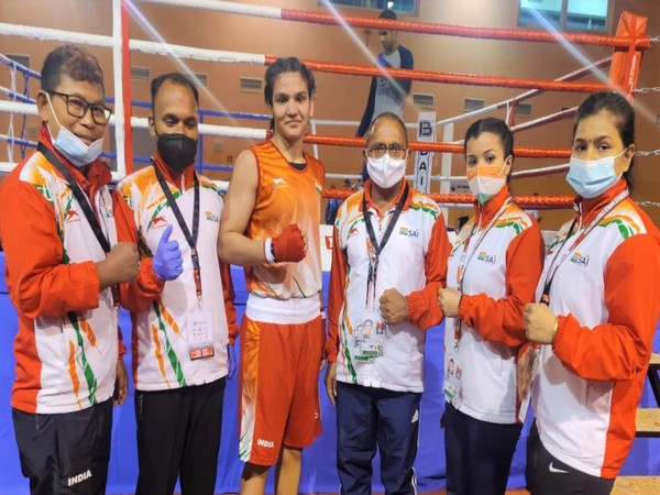 Arundhati Choudhary poses after winning her pre-quarterfinals bout