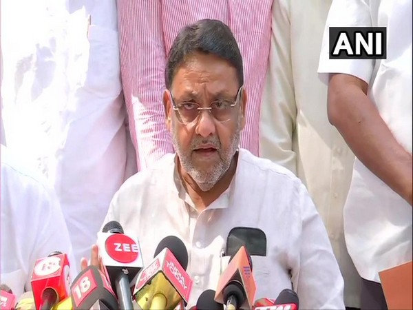 Nationalist Congress Party chief Nawab Malik speaking to media in Mumbai on Monday. (Photo/ANI)