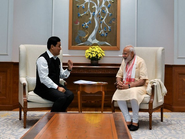 Chief Minister of Assam, Sabanand Sonwal with Prime Minister Narendra Modi on Wednesday in New Delhi. Photo credit: PMO India (Twitter @PMOIndia)