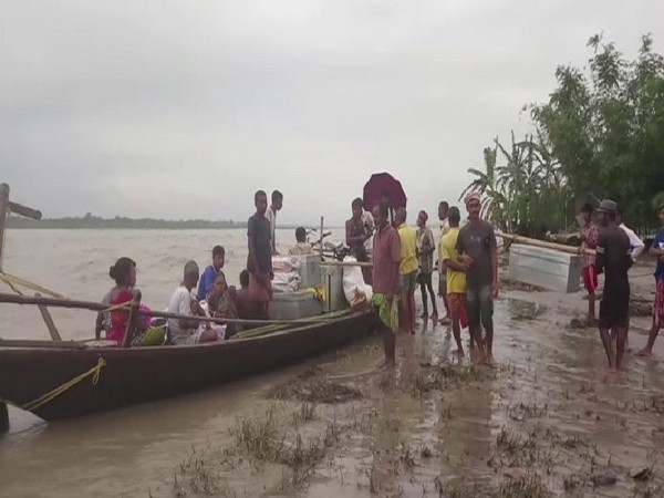 Residents of Dababil village of Chirang district in Assam flee as floods threaten their lives