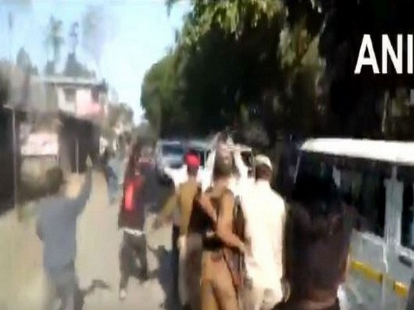 Police try to stop AASU workers from showing flags to CM's convoy in Dibrugarh Photo/ANI