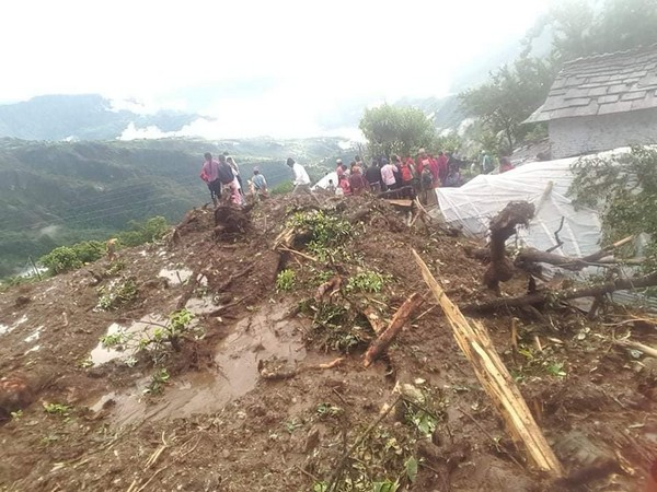 Officials conducting relief work post landslide in Nepal on Sunday. Photo/ANI