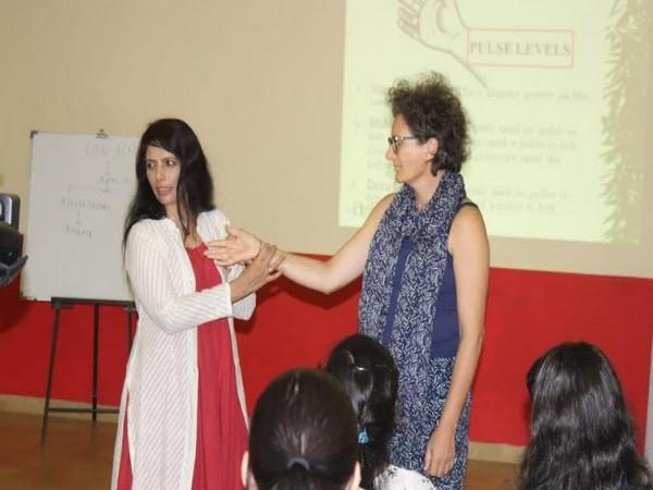 Vaidya Smita Naram, the Founder of Ayushakti Ayurved explaining the finer points of pulse reading