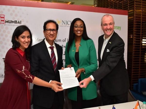 Priyanka Nishar, Atul Nishar, Tamara Cunningham and Governor, Phil Murphy signing the consulting agreement
