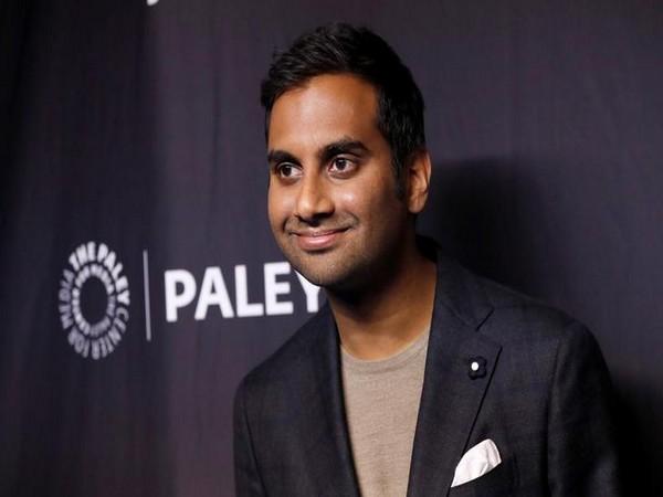 Aziz Ansari posing at an event