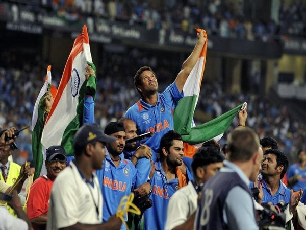 Indian team carrying Sachin Tendulkar on their shoulders after 2011 World Cup win