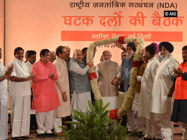 Prime Minister Narendra Modi being garlanded during the dinner meet of NDA leaders in New Delhi on Tuesday night. Photo/ANI