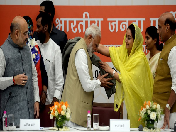 Prime Minister Narendra Modi being felicitated by SAD leader and Union Minister Harsimrat Kaur during the meeting at the BJP office in New Delhi on Tuesday. Photo/ANI