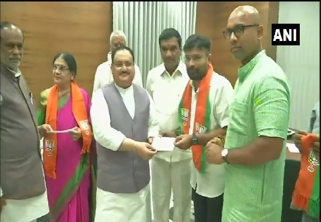 TDP leader Annapurnamma, her son Mallikarjun Reddy joining BJP in New Delhi on Saturday.