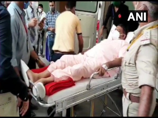 BJP MLA from Matar assembly constituency, Kesarisinh Jesangbhai Solanki arrives in an ambulance to vote in Rajya Sabha Election in Gandhinagar, Gujarat on Friday. (Photo/ANI)