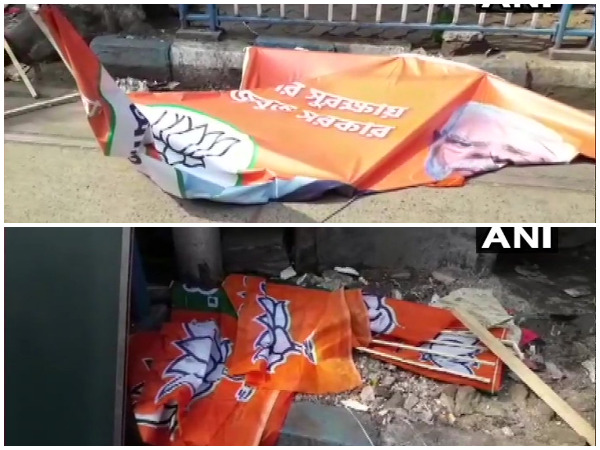 BJP's party flags and posters lying on a road in Kolkata.