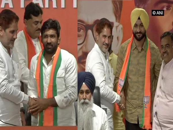 Olympic Medallist Yogeshwar Dutt (l) and former Hockey captain Sandeep Singh join BJP on Thursday. (Photo/ANI)