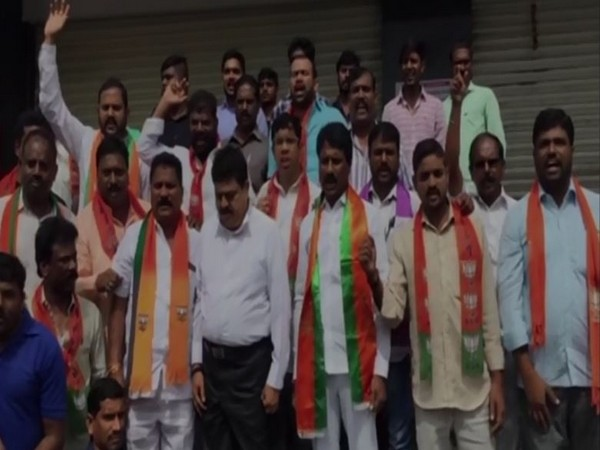 BJP members led by MLC Rao protesting outside hospital on Monday.