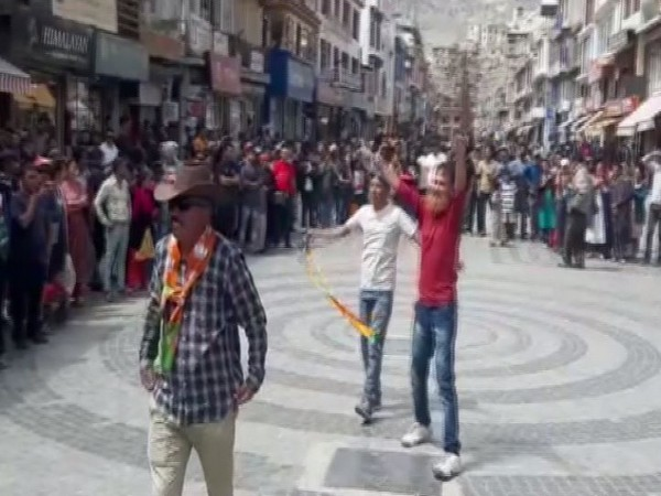 BJP workers celebrating the scrapping of section 370 on Monday in Leh. Photo/ANI