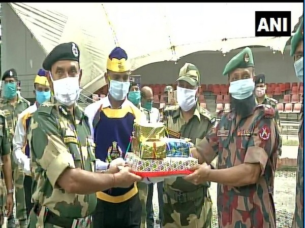 BSF and BGB exchanged sweets at Petrapole border on Saturday. (Photo: ANI)