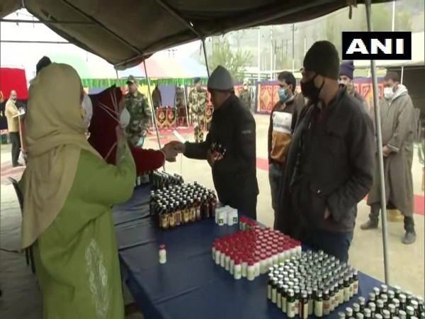 People receive medicines at the camp in Srinagar on Friday. (Photo/ANI)