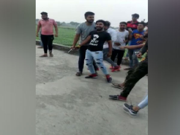 In a viral video, a group of youngsters were seen indulging in celebratory firing in Sarurpur Kherki village. Photo/ANI