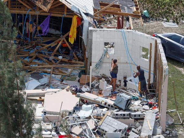 Residents look for their belongings in Grand Bahama on Wednesday after Hurricane Dorian ravaged the Bahamas earlier this week. (Photo Credits: Reuters)