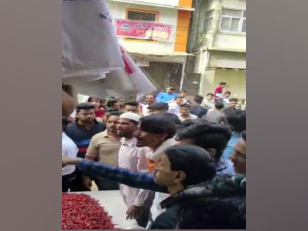 A trader used red chilli powder to stop protestors from closing his shop. Photo/ANI