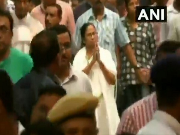 West Bengal Chief Minister Mamata Banerjee participating in a march in Kolkata on Wednesday.