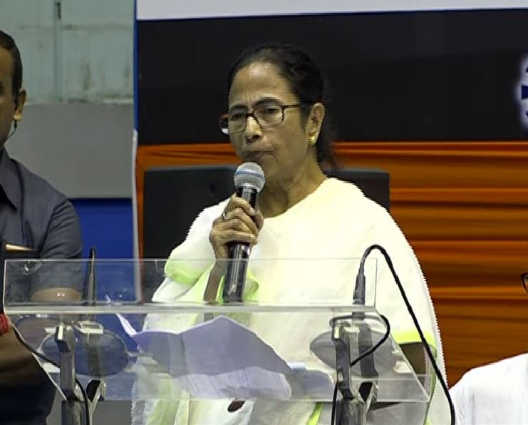 West Bengal CM Mamata Banerjee speaking at an event of INTTUC in Kolkata on Monday. (Photo/ANI)