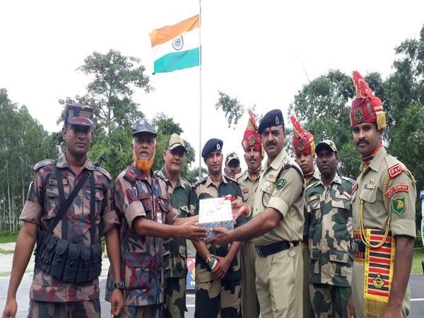 Sweets exchanged at India-Bangladesh border between Border Security Force(BSF) and Border Guards Bangladesh(BGB)