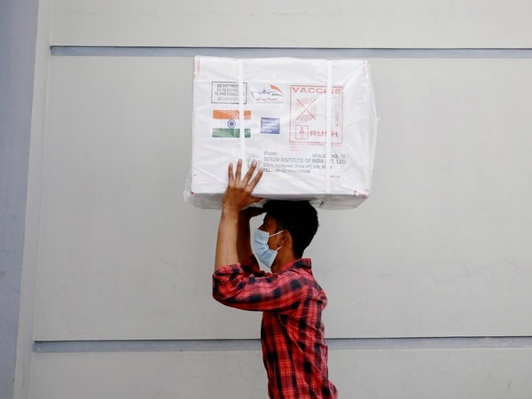 A worker carrying Oxford-AstraZeneca vaccine received as as a gift from India to Bangladesh (Photo Credit - Reuters)