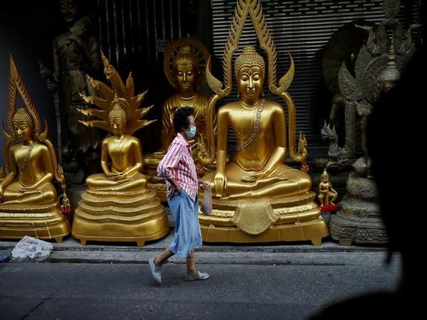 A woman wears a mask as a preventive measure against the coronavirus outbreak, in Bangkok