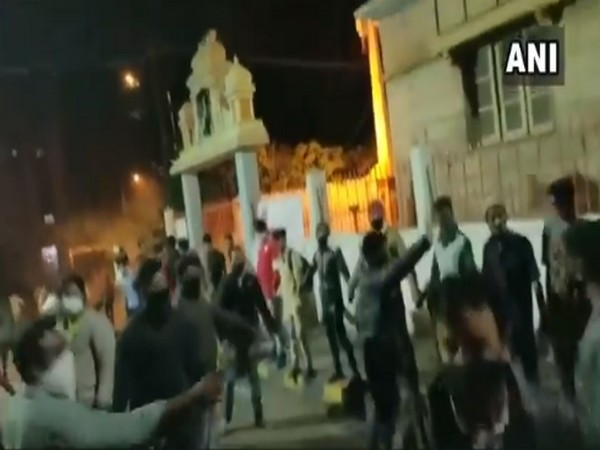 Screengrab of the video which shows Muslim youth forming human chain outside temple on Tuesday night.
