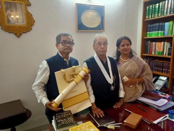 Former President Pranab Mukherjee (middle) with his son Abhijit Mukherjee (left) and daughter Sharmistha Mukherjee (right). (Photo credit: @ABHIJIT_LS Twitter)