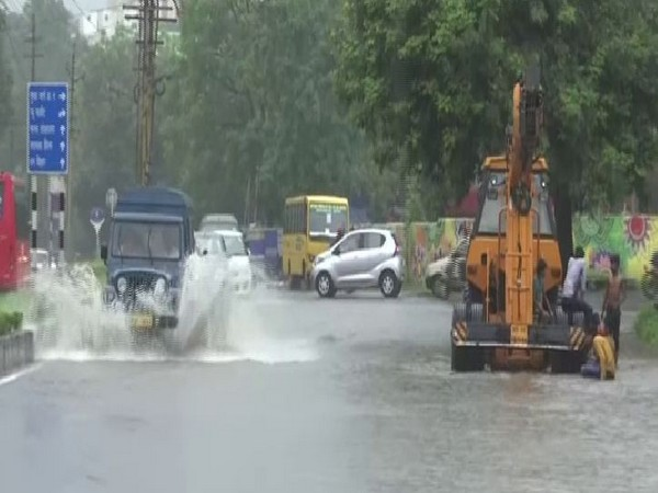 Vehicles wading through a waterlogged street in Bhopal on Monday. Photo/ANI