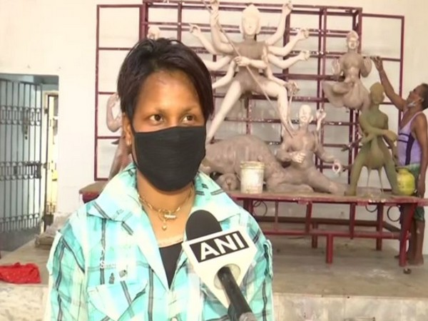 24-year-old daughter quits study to help father making idols in Bhubaneswar. Photo/ANI