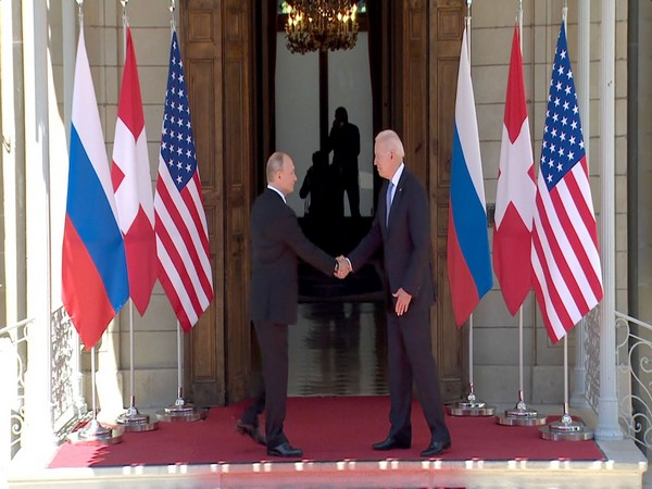 US President greets Russian counterpart Vladimir Putin with a handshake in Geneva (Photo Credit - CNN)