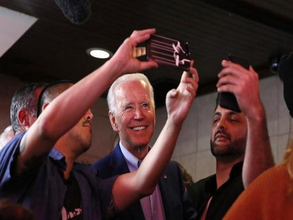 US Democratic presidential candidate Joe Biden takes selfies with fans in Los Angeles