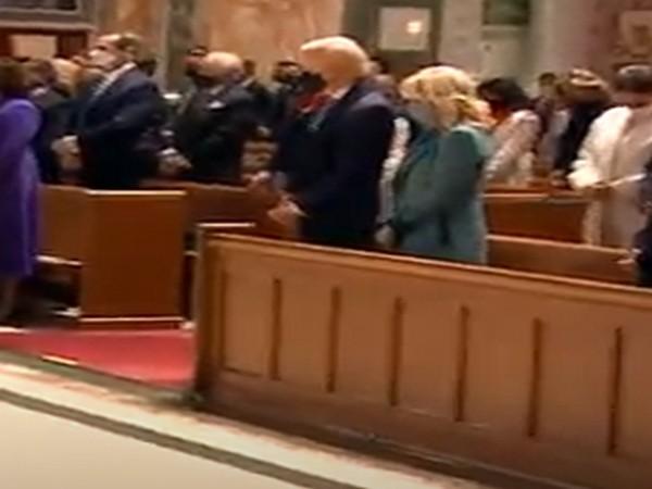 US President-elect Joe Biden and First Lady-elect Jill Biden attend Mass