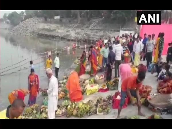 Devotees take part in Chhath Puja celebrations at ghats near Aurai (Photo ANI)
