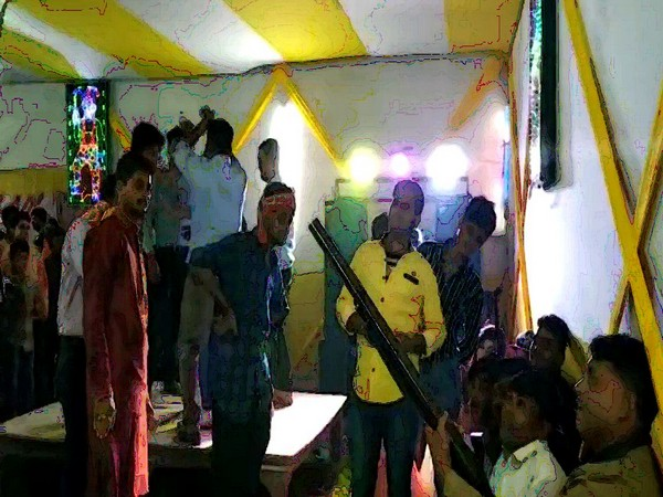 A man shooting in the air at a wedding ceremony in Arrah, Bihar.