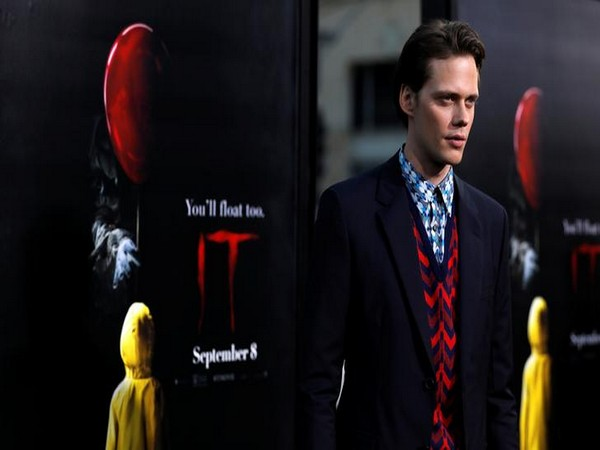 "Bill Skarsgard poses at the premiere for ""It"" in 2017"