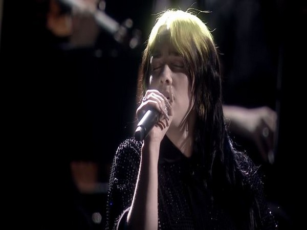 A still of singer Billie Eilish from her debut performance of Bond Song 'No Time to Die' at the 2020 Brit Awards on Tuesday (local time) (Image courtesy: YouTube)