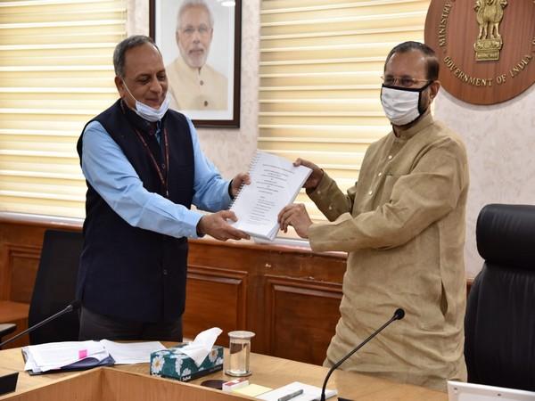Bimal Julka submitting review report to Prakash Javadekar on Tuesday. Photo/ANI