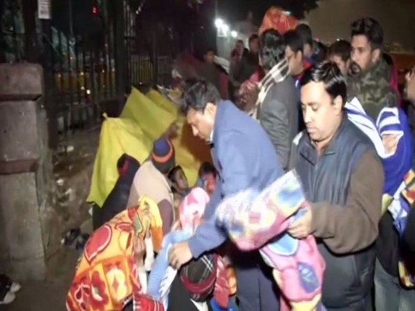 Youth Congress distributed blankets outside AIIMS on Sunday.