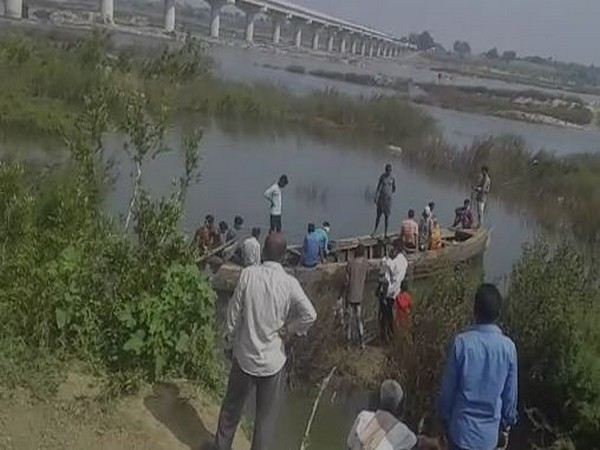 Rescue operations underway to fish out bodies of two forest officers who drowned in Pranahitha river on Sunday morning. (Photo/ANI)
